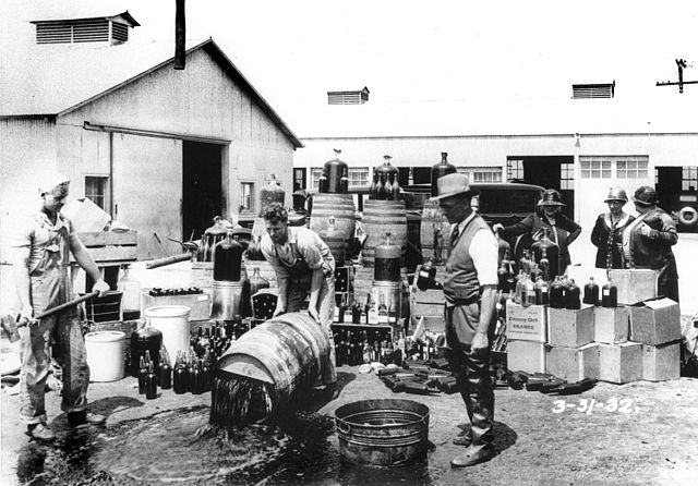 640px-Orange_County_Sheriff's_deputies_dumping_illegal_booze,_Santa_Ana,_3-31-1932.jpg